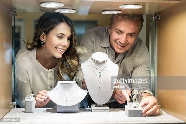 woman shopping at a jewelry store - jewelry store stock pictures, royalty-free photos & images