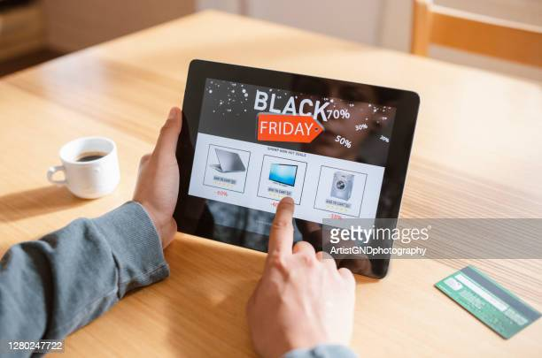 woman shopping at black friday. - black friday stock pictures, royalty-free photos & images