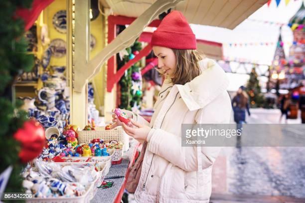 Woman shopping at Christmas market
