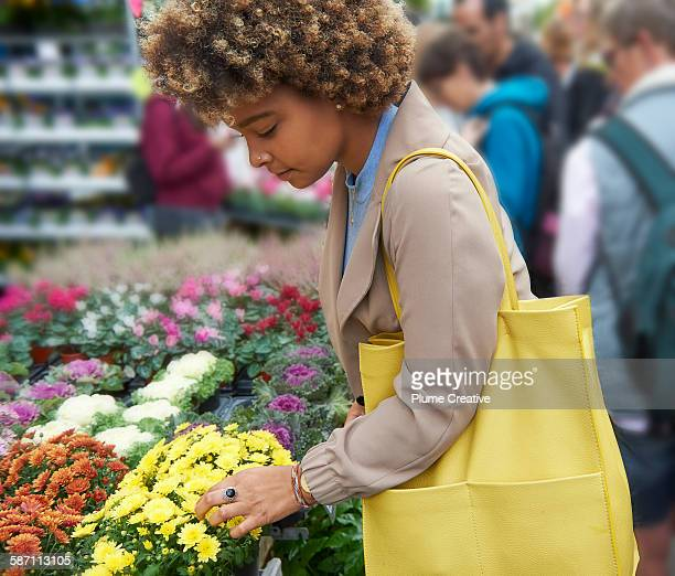 woman shopping at flower market. - shoulder bag stock pictures, royalty-free photos & images