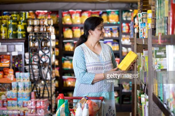 woman shopping at grocery store - buying stock pictures, royalty-free photos & images