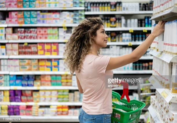 woman shopping at the supermarket - hair care stock pictures, royalty-free photos & images