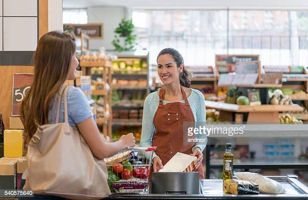 woman shopping at the supermarket - cashier stock pictures, royalty-free photos & images