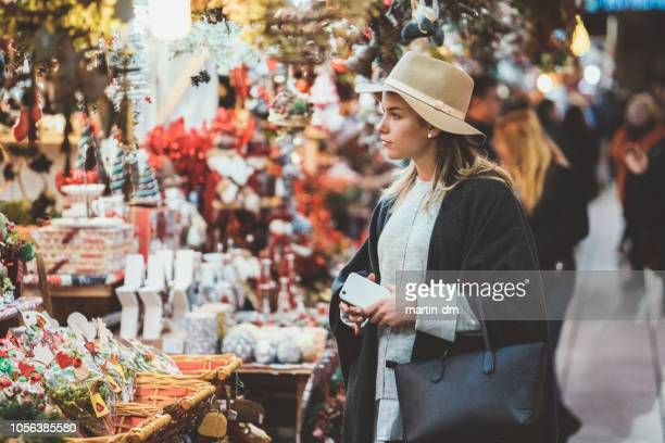 woman shopping christmas presents - market stall stock pictures, royalty-free photos & images