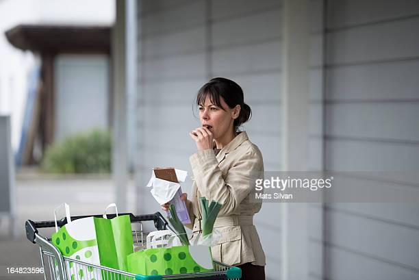 Woman shopping food in a supermarket