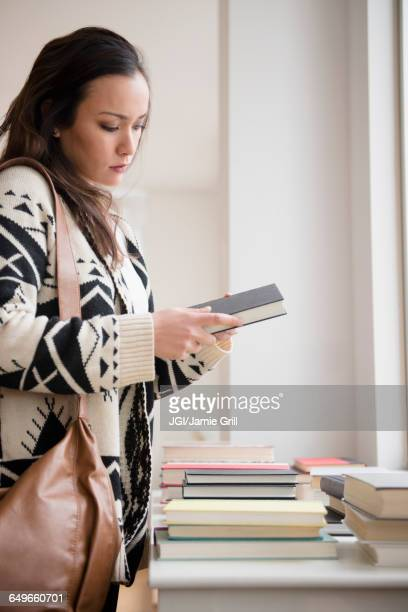 Woman shopping for books in bookstore