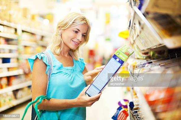 Woman shopping for cereals.