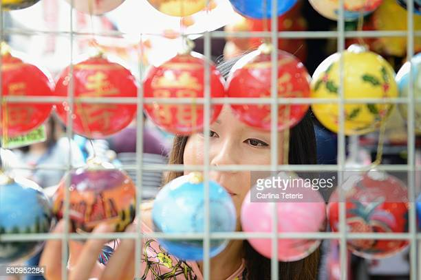 Woman shopping for Chinese Christmas ornaments at a market
