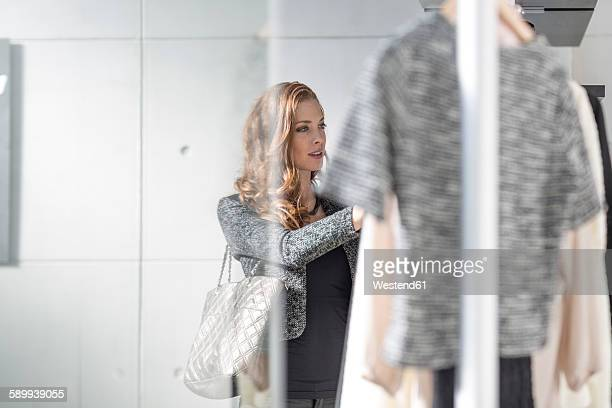 woman shopping for clothes - boutique stock photos and pictures