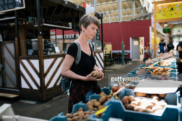 A Woman Shopping For Food At A Market