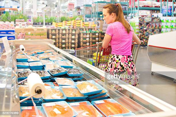 woman shopping for fresh fish seafood in supermarket retail store - big fish stock pictures, royalty-free photos & images