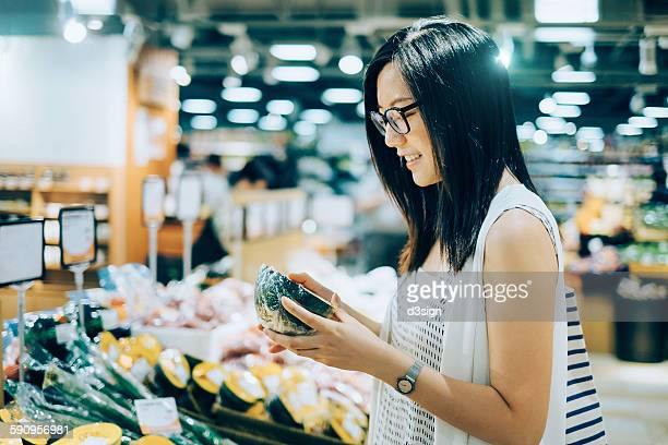 Woman shopping for fresh produces in a supermarket