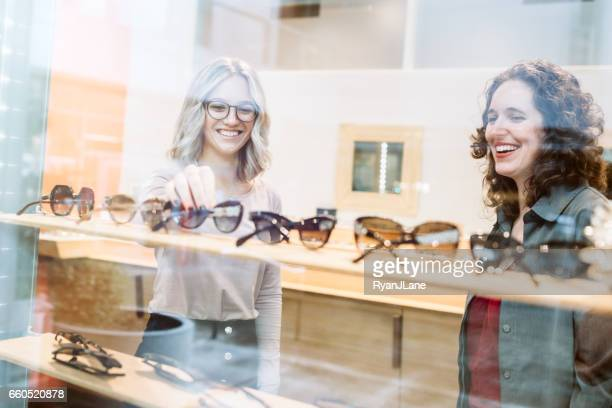 woman shopping for glasses - sunglasses stock pictures, royalty-free photos & images