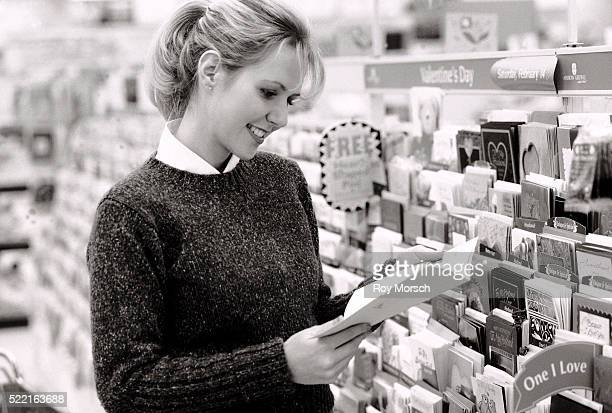 Woman shopping for greeting cards