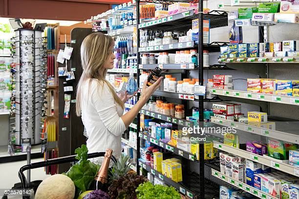 woman shopping for health and beauty supplies - nutritional supplement stock pictures, royalty-free photos & images