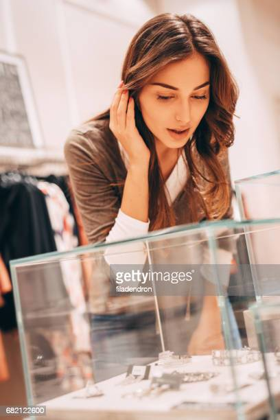 woman shopping for jewelry - jeweller stock photos and pictures