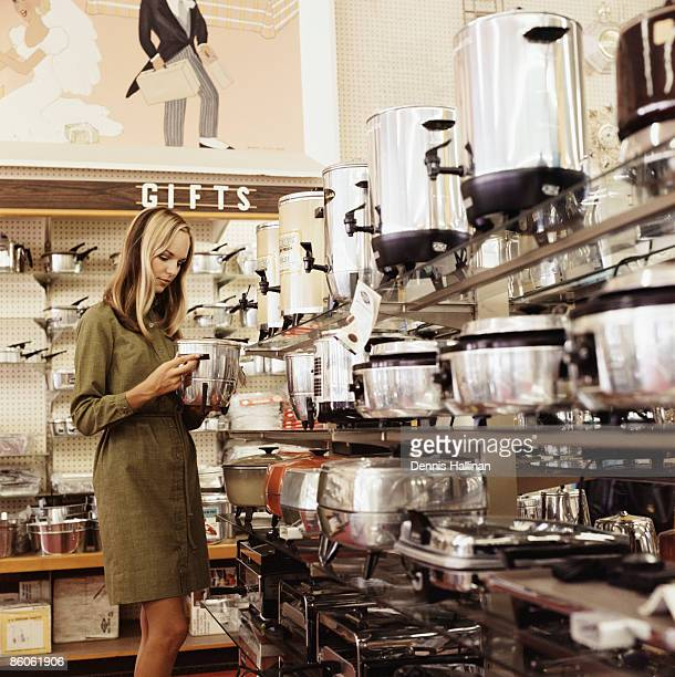woman shopping for kitchen appliances - articoli casalinghi foto e immagini stock