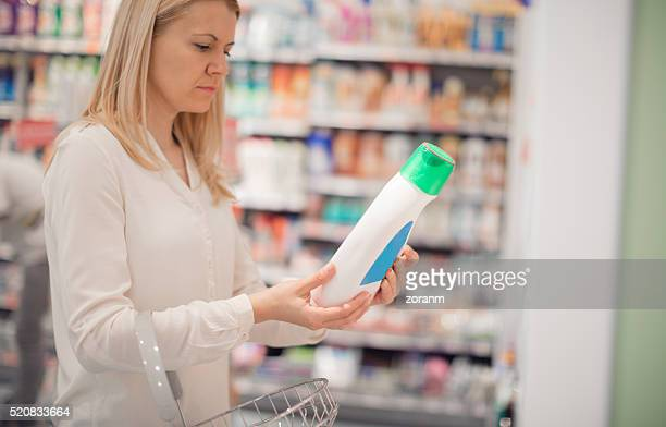 Woman shopping for luiquid detergent