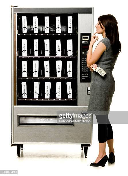 woman shopping for plastic surgery in a vending machine