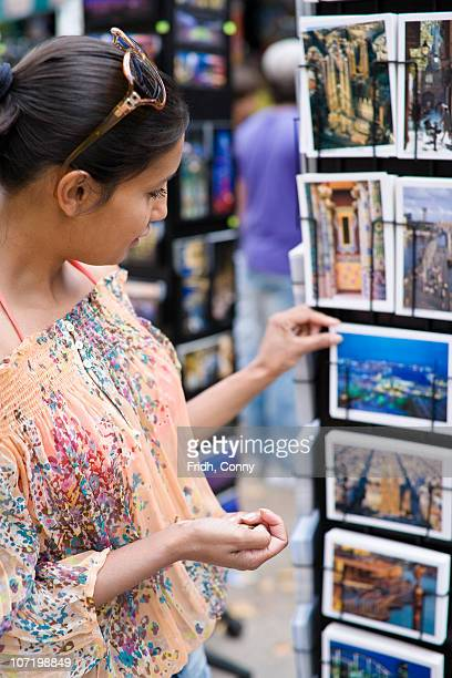 Woman shopping for postcards