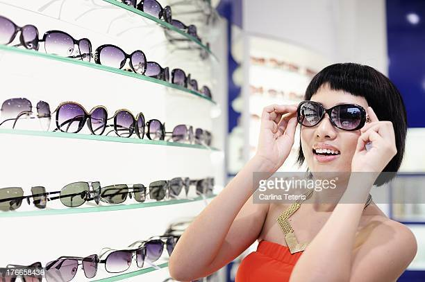 Woman shopping for sunglasses