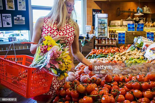 Woman shopping for vegetables in supermarket