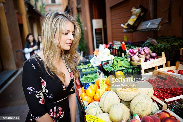 Woman shopping in a street market in Bologna, Italy