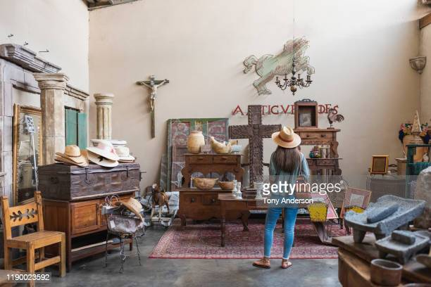 woman shopping in antique store - western script stock pictures, royalty-free photos & images