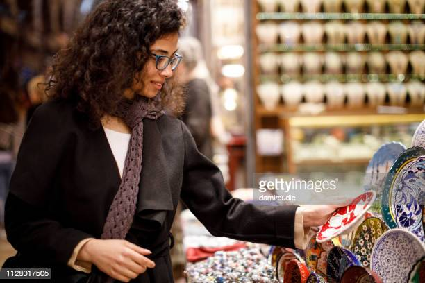 woman shopping in bazaar market, istanbul - painting art product stock pictures, royalty-free photos & images