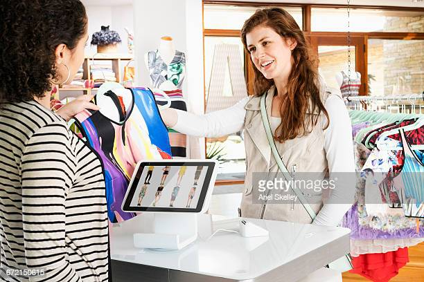 Woman shopping in clothing store buying blouse