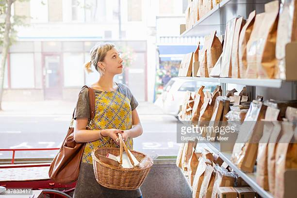 Woman shopping in delicatessen shop.