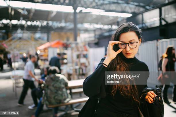 woman shopping in east london second hand marketplace - shoreditch stock photos and pictures
