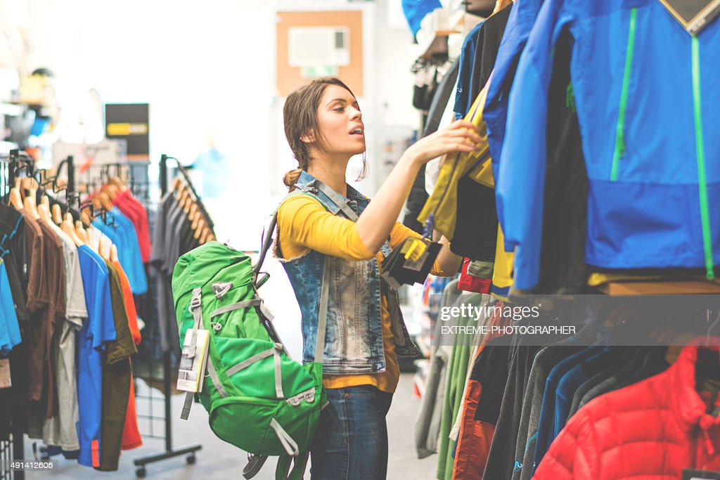 Woman shopping in outdoor equipment mega store : Stock Photo