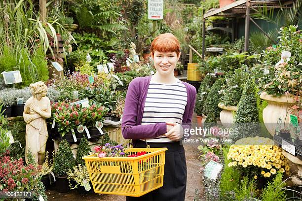 Woman shopping in plant nursery.