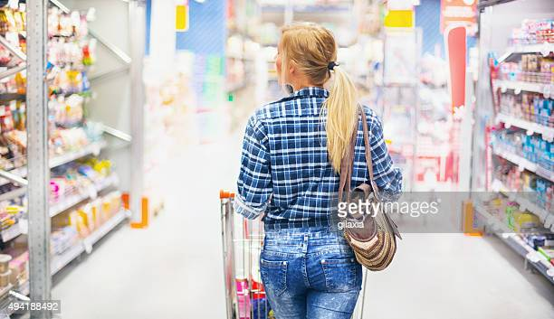 Woman shopping in supermarket.