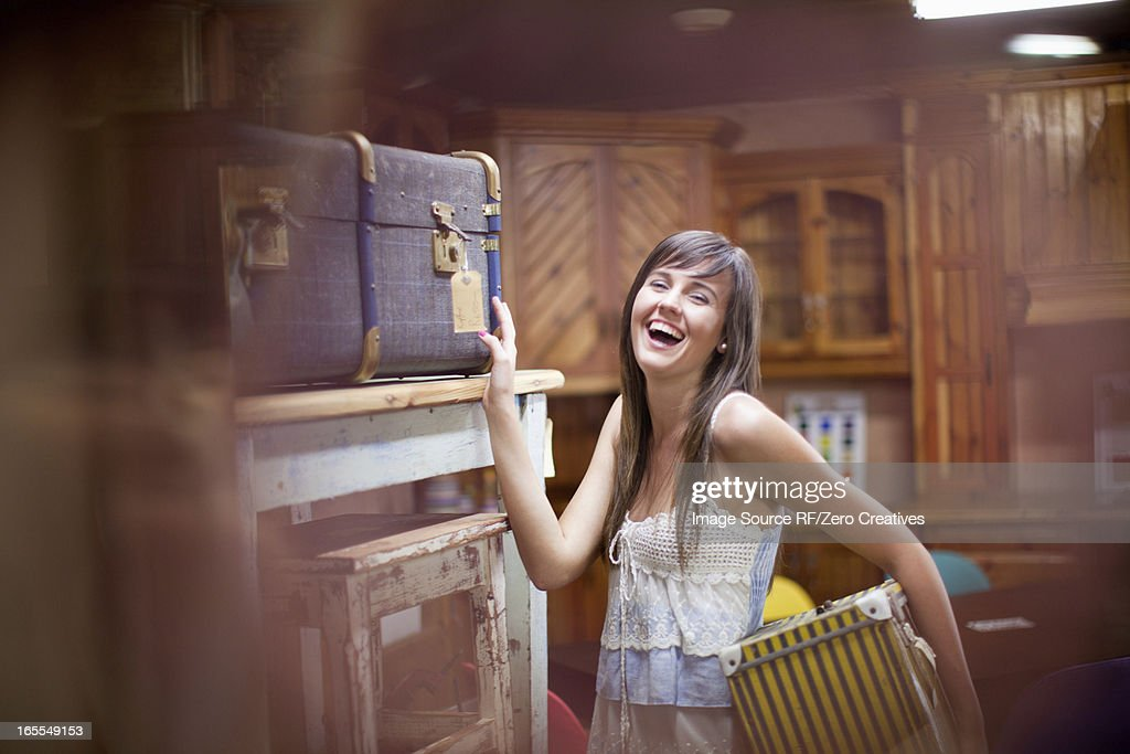 Woman shopping in thrift store : Stock Photo