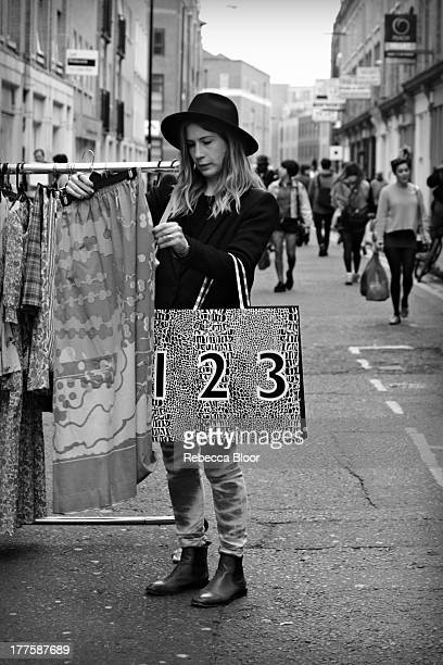 Woman shopping in vintage market. Brick Lane, London, 2012