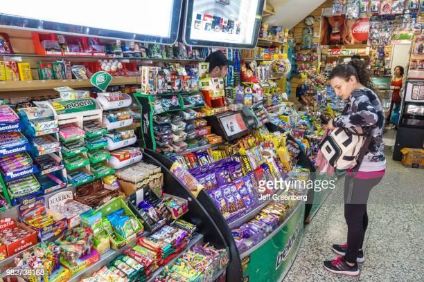 A woman shopping inside Maxikiosco Sinclair