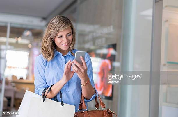 Woman shopping using her cell phone