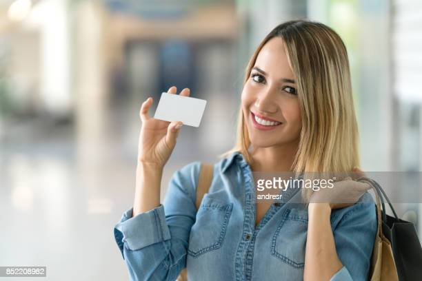 Woman shopping with a credit card at the mall
