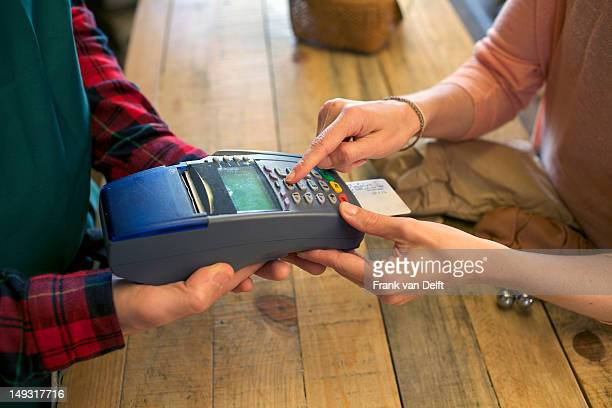 Woman shopping with credit card in store