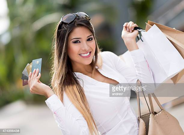Woman shopping with credit cards