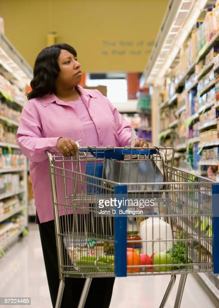 Woman shopping with grocery cart