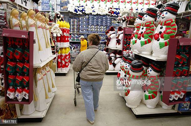A woman shops among Christmas items November 13 2002 at a WalMart store in Mount Prospect Illinois WalMart Stores Inc reported record sales and...