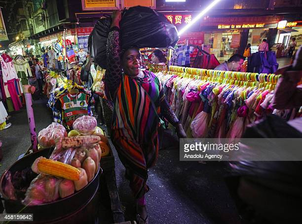 """Woman shops at a market in the """"African village"""" in Guangzhou, Guangdong province, October 29, 2014. Chinese authorities have identified the southern..."""