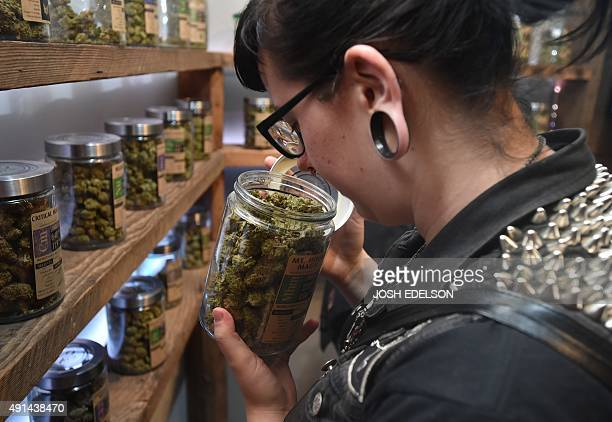 A woman shops at Oregon's Finest a marijuana dispensary in Portland Oregon on October 4 2015 As of October 12015 limited amounts of recreational...