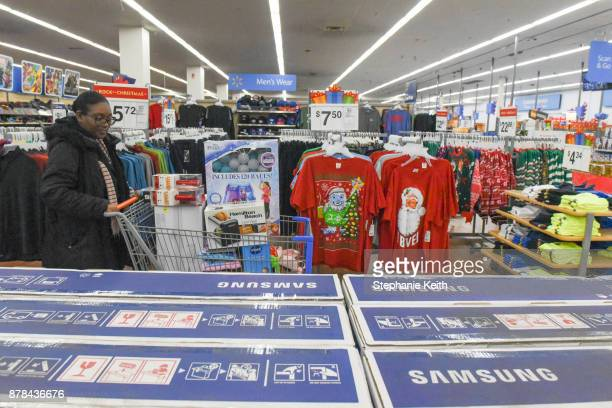 A woman shops at Walmart near the Green Acres Mall on Black Friday on November 24 2017 in Valley Stream NY