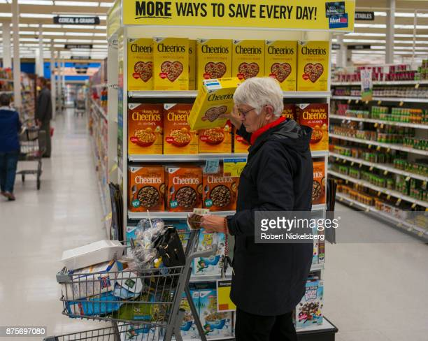 A woman shops for Cheerios cereal at a Price Chopper supermarket in South Burlington Vermont November 6 2017 Price Chopper is a chain of supermarkets...