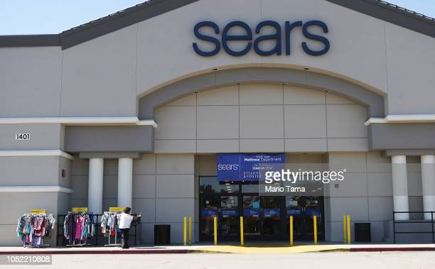 Woman shops for clearance items in front of a Sears store on October 15, 2018 in Montebello, California. The iconic American retailer has filed for...