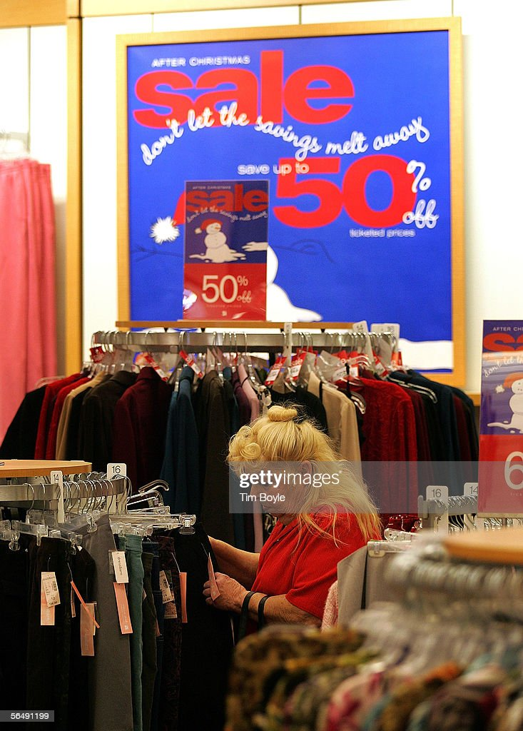 A woman shops for clothing near 'After-Christmas Sale' signage in a Dress Barn store December 27, 2005 in Mount Prospect, Illinois. Retailers are marking down prices as consumers are looking for post-Christmas deals.
